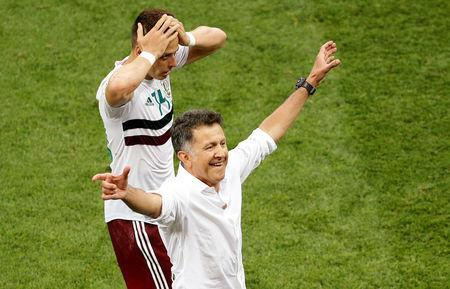 Soccer Football - World Cup - Group F - South Korea vs Mexico - Rostov Arena, Rostov-on-Don, Russia - June 23, 2018 Mexico coach Juan Carlos Osorio and Javier Hernandez celebrate victory after the match REUTERS/Darren Staples