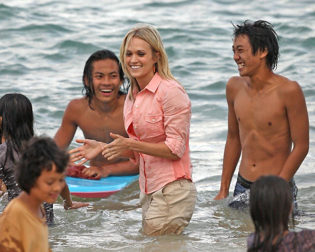 Singer Carrie Underwood and Anasophia Robb filming an after Tsunami scene for the movie Soul Surfer in Hawaii.