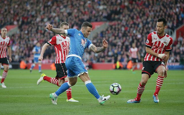 <span>Jack Wilshere whips in a cross</span> <span>Credit: REX FEATURES </span>