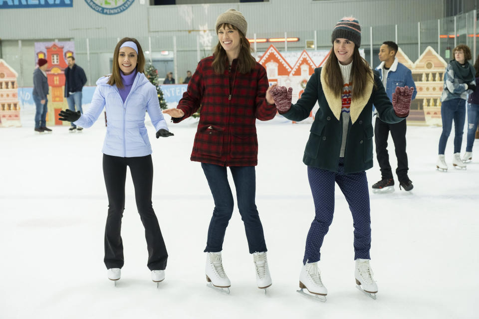 "This image released by Hulu shows Alison Brie, Mackenzie Davis, and Mary Holland in a scene from ""Happiest Season."" (Lacey Terrell/Hulu via AP)"