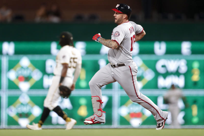 Washington Nationals' Matt Adams runs into second base behind Pittsburgh Pirates first baseman Josh Bell with double driving in Asdrubal Cabrera in the fourth inning of a baseball game, Monday, Aug. 19, 2019, in Pittsburgh. (AP Photo/Keith Srakocic)