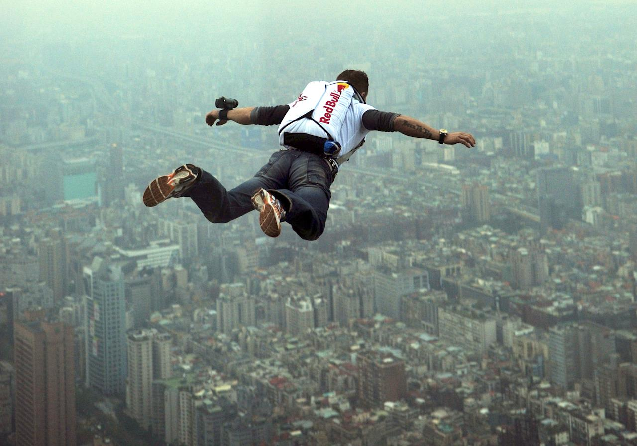 This image provided by the Euro-Newsroom agency shows Austrian base jumper Felix Baumgartner leaping off the Taipei 101 skyscraper in Taiwan Tuesday Dec. 11, 2007. Baumgartner leapt from the 1,676 foot (509 meters) tall building Tuesday after evading security and having to clear a barrier before being able to make his leap. (AP Photo/Joerg Mitter, Euro-Newsroom)