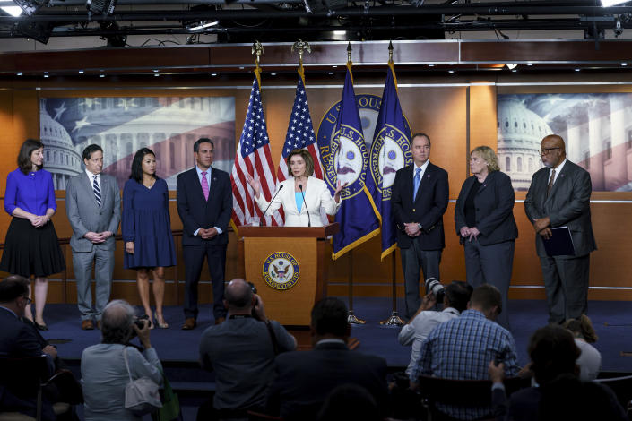 Speaker of the House Nancy Pelosi, D-Calif., announces Democratic appointments to a new select committee to investigate the violent Jan. 6 insurrection at the Capitol, on Capitol Hill in Washington, Thursday, July 1, 2021. From left are Rep. Elaine Luria, D-Va., Rep. Jamie Raskin, D-Md., Rep. Stephanie Murphy, D-Fla., Rep. Pete Aguilar, D-Calif., Rep. Adam Schiff, D-Calif., Rep. Zoe Lofgren, D-Calif., and Rep. Bennie Thompson D-Miss., who will lead the panel. Rep. Liz Cheney, R-Wyo., who was ousted from the GOP leadership for criticizing Trump, accepted Pelosi's invitation to join the committee. (AP Photo/J. Scott Applewhite)