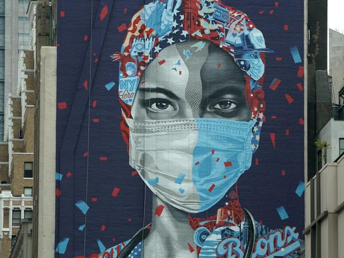 A mural honoring healthcare workers at Montefiore Medical Center in the Bronx is seen on the side of a building in Midtown Manhattan May 11, 2020 in New York