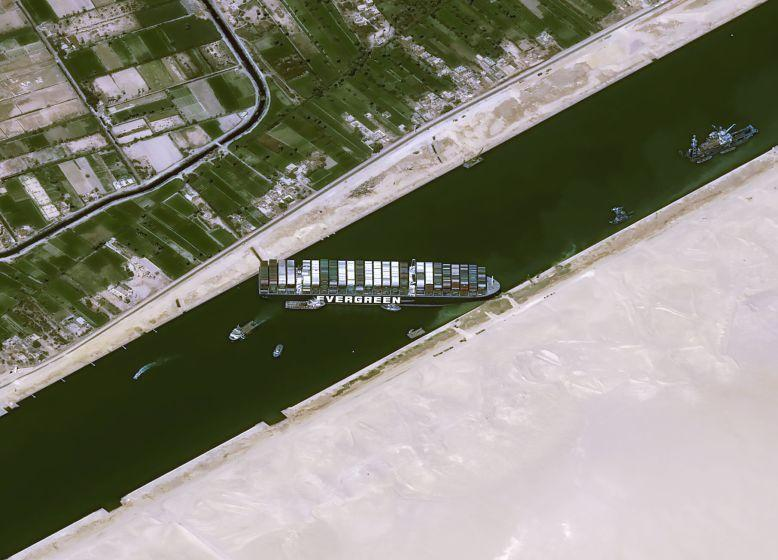 This satellite image from Cnes2021, Distribution Airbus DS, shows the cargo ship MV Ever Given stuck in the Suez Canal near Suez, Egypt, Thursday, March 25, 2021. The skyscraper-sized cargo ship wedged across Egypt's Suez Canal further imperiled global shipping Thursday as at least 150 other vessels needing to pass through the crucial waterway idled waiting for the obstruction to clear, authorities said. (Cnes2021, Distribution Airbus DS via AP)