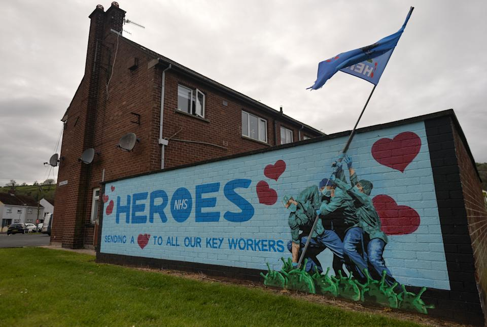 An Iwo Jima Memorial inspired NHS Heroes Mural by artists Ricky Morrow and Dee Craig in the village of Glynn near Larne, in County Antrim. On Tuesday, April 20, 2021, in Glynn, County Antrim, Northern Ireland (Photo by Artur Widak/NurPhoto via Getty Images)