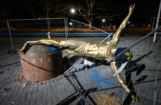 "The staue of <a class=""link rapid-noclick-resp"" href=""/soccer/players/374294/"" data-ylk=""slk:Zlatan Ibrahimovic"">Zlatan Ibrahimovic</a> in Malmo, Sweden was vandalized yet again following Ibrahimovic's announcement that he was buying shares in a rival Swedish soccer club. (Photo by JOHAN NILSSON/TT News Agency/AFP via Getty Images)"