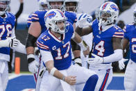 Buffalo Bills' Josh Allen (17) celebrates with teammate Stefon Diggs (14) after scoring a touchdown during the first half of an NFL wild-card playoff football game against the Indianapolis Colts, Saturday, Jan. 9, 2021, in Orchard Park, N.Y. (AP Photo/Adrian Kraus)