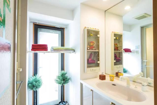 <p>Here's the bathroom with quirky Nintendo-themed details throughout. </p>