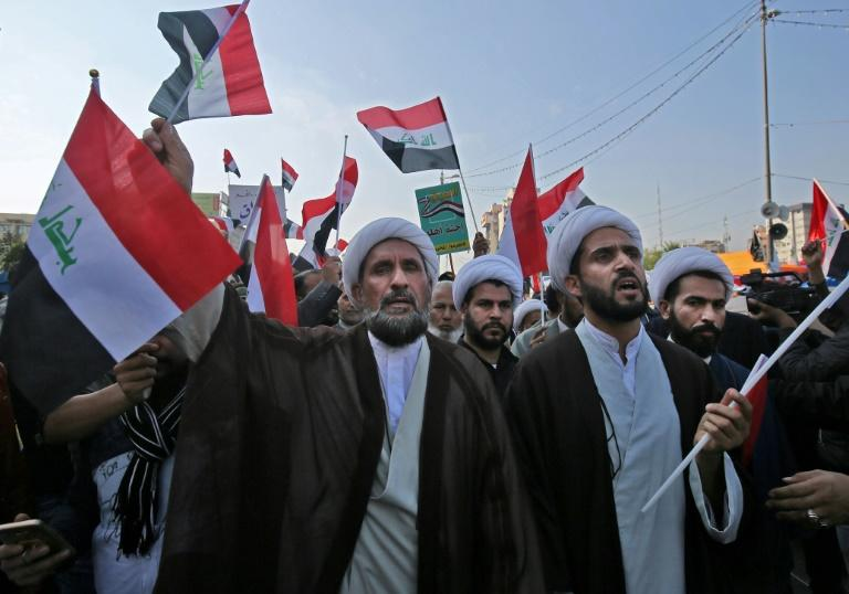 Iraqi Shiite Muslim clerics, supporters of the Hashed al-Shaabi armed network, demonstrate in Baghdad