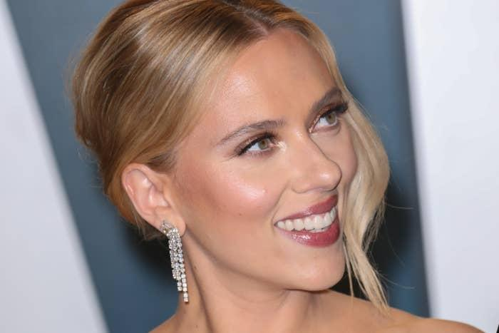 Scarlett Johansson is pictured smiling at the 2020 Vanity Fair Oscar Party