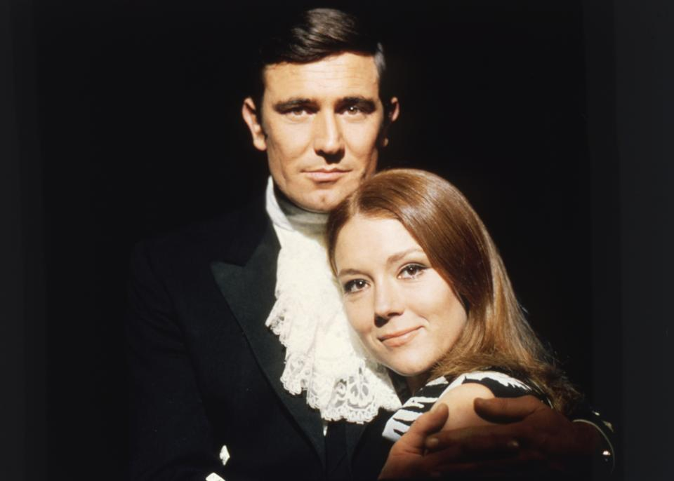 British actress Diana Rigg and Australian actor George Lazenby on the set of On Her Majesty's Secret Service, directed by British Peter R. Hunt. (Photo by Sunset Boulevard/Corbis via Getty Images)