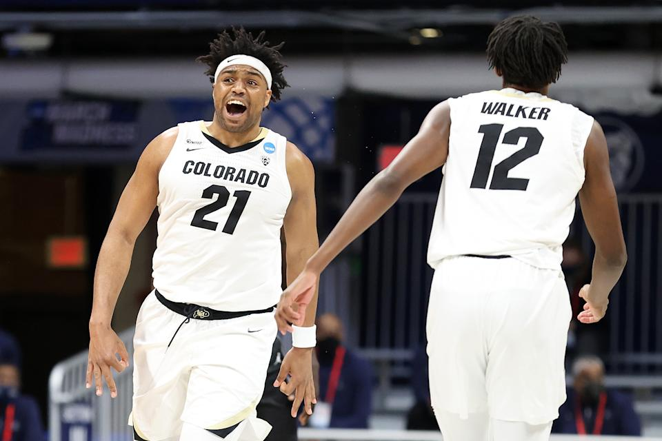 INDIANAPOLIS, INDIANA - MARCH 20: Evan Battey #21 of the Colorado Buffaloes reacts to a play against the Georgetown Hoyas in the first round game of the 2021 NCAA Men's Basketball Tournament at Hinkle Fieldhouse on March 20, 2021 in Indianapolis, Indiana. (Photo by Andy Lyons/Getty Images)