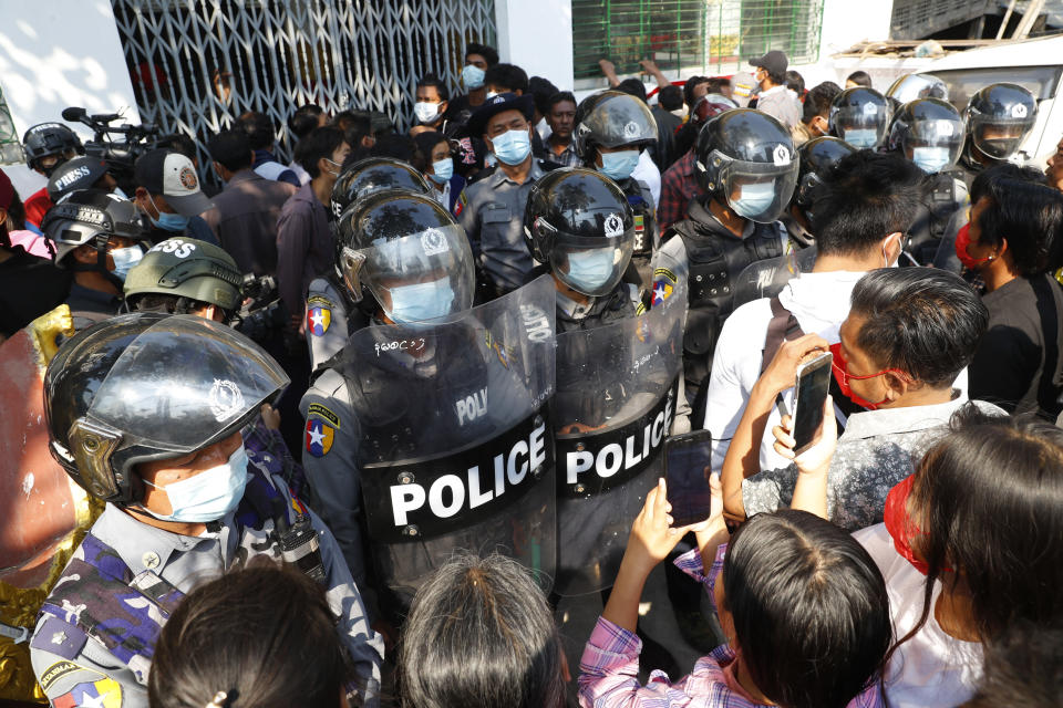 Residents and protesters face riot police as they question them about recent arrests made in Mandalay, Myanmar, Saturday, Feb. 13, 2021. Daily rallies against the coup occurring in Myanmar's two largest cities, Yangon and Mandalay, enter its second week despite a ban on public gatherings of five or more. (AP Photo)