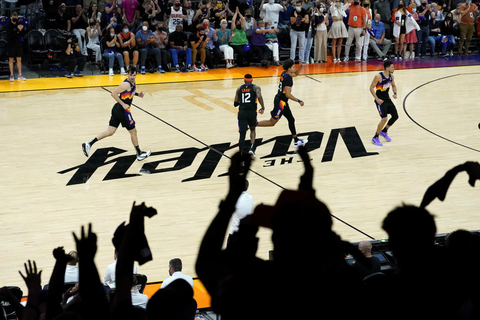 From left; Phoenix Suns forward Dario Saric, forward Torrey Craig, forward Cameron Johnson and guard Devin Booker celebrate after a basket against the Denver Nuggets during the second half of Game 2 of an NBA basketball second-round playoff series, Wednesday, June 9, 2021, in Phoenix. (AP Photo/Matt York)