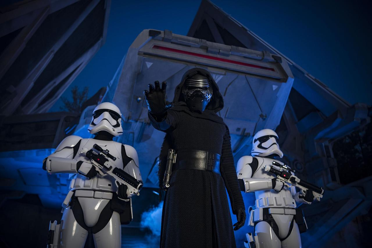 """<p>While on our exclusive tour of <a href=""""https://www.popsugar.com/family/Disney-Star-Wars-Galaxy-Edge-Details-2019-45710196"""" class=""""ga-track"""" data-ga-category=""""Related"""" data-ga-label=""""http://www.popsugar.com/family/Disney-Star-Wars-Galaxy-Edge-Details-2019-45710196"""" data-ga-action=""""In-Line Links"""">Star Wars: Rise of the Resistance</a> with Scott Trowbridge, Portfolio Creative Executive for Walt Disney Imagineering, we learned more about the story line of the ride. Guests will enter an old Resistance base where they will pass by Poe Dameron's ship from <a href=""""https://www.popsugar.com/latest/star-wars-the-force-awakens"""" class=""""ga-track"""" data-ga-category=""""Related"""" data-ga-label=""""https://www.popsugar.com/latest/star-wars-the-force-awakens"""" data-ga-action=""""In-Line Links""""><strong>Star Wars: The Force Awakens</strong></a> and meet up with General Organa and other beloved characters from the Star Wars films and TV shows. Seeing favorite Star Wars friends is sure to be a highlight for kids who have always dreamed of coming face-to-face with the likes of Rey or Kylo Ren. </p> <p>Then riders will enter a sort of transport ship that will launch them into space, but things go awry and the transport is intercepted by the First Order and into a hangar bay of a Star Destroyer. After being caught captive by <a href=""""https://www.popsugar.com/entertainment/Kylo-Ren-Become-Good-Star-Wars-Episode-9-46030410"""" class=""""ga-track"""" data-ga-category=""""Related"""" data-ga-label=""""https://www.popsugar.com/entertainment/Kylo-Ren-Become-Good-Star-Wars-Episode-9-46030410"""" data-ga-action=""""In-Line Links"""">Kylo Ren</a> and the First Order officers, you're going to need to find a way out of the Star Destroyer and back to the Resistance Base. Guests will board trackless ride vehicles and search through the destroyer to find the escape pods to crash land back on Batuu. </p> <p>In all, guests will have four separate ride systems, see old and new Star Wars characters, and be fully immersed in a massive Star Wa"""