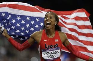 USA's Sanya Richards-Ross reacts after winning the women's 400-meter during the athletics in the Olympic Stadium at the 2012 Summer Olympics, London, Sunday, Aug. 5, 2012. (AP Photo/Markus Schreiber)