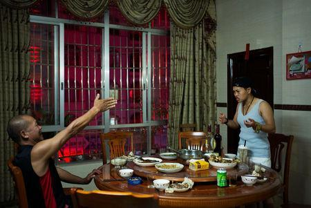 Huang Wensi and her father argue over family matters during a dinner at home in Lianjiang, Guangdong province, China, June 30, 2018. REUTERS/Yue Wu