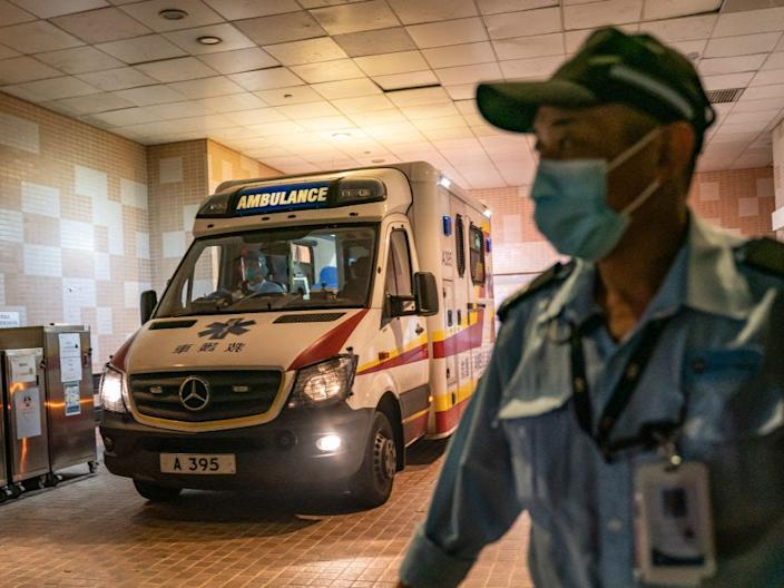 A security official stands guard as an ambulance arrives with a patient at Princess Margaret Hospital in Hong Kong on January 22.