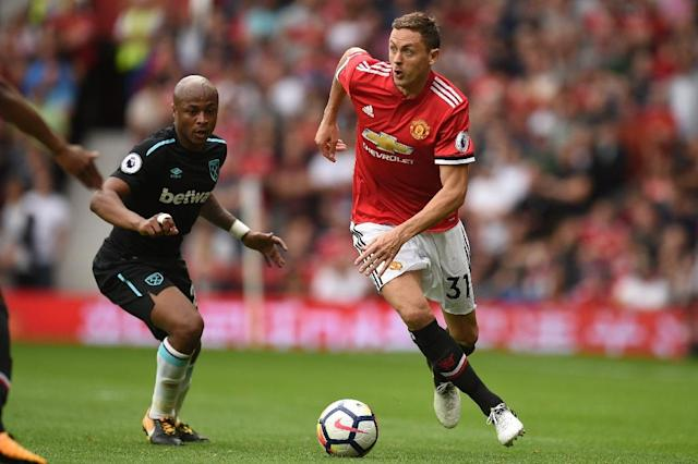 Manchester United's Serbian midfielder Nemanja Matic (R) won over the crowd with his ball control, and he helped both his team and his popularity when he successfully countered an attempted pass by Pedro Obiang, allowing Man United to score (AFP Photo/Oli SCARFF )