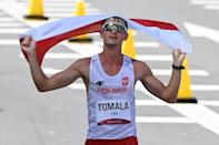 Poland's Dawid Tomala won the men's 50km race walk in hot conditions in Sapporo