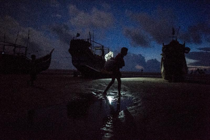 Bangladesh border guards destroyed at least 30 wooden fishing boats after they were intercepted Tuesday evening bringing more than 700 Rohingya Muslims across the river from Myanmar's westernmost Rakhine state