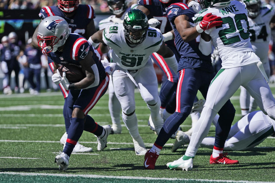 New England Patriots' James White, left, runs for a touchdown during the first half of an NFL football game against the New York Jets, Sunday, Sept. 19, 2021, in East Rutherford, N.J. (AP Photo/Frank Franklin II)