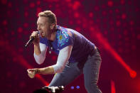 "FILE - Chris Martin of Coldplay performs at Metlife Stadium in East Rutherford, N.J. on August 1, 2017. Coldplay's ""Everyday Life"" is nominated for a Grammy Award for best album. The 63rd Annual Grammy Awards will be held on March 14. (Photo by Scott Roth/Invision/AP, File)"