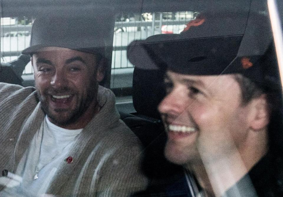 The pair grinned as they got into a waiting car. Copyright: [Rex]