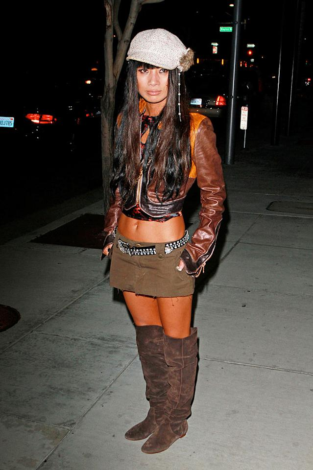 "Bai Ling strikes again! This time, the struggling actress popped a pose in a mismatched mess consisting of a belly-baring leather jacket, belted mini, and thigh-high suede boots. Anthony/<a href=""http://www.pacificcoastnews.com/"" target=""new"">PacificCoastNews.com</a> - September 6, 2010"