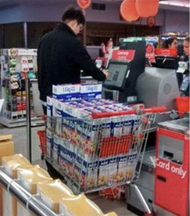 This man is seen in Melbourne stocking up on the cheap grocery item. Photo: Twitter/RossandJohn