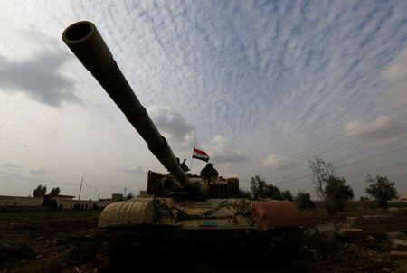 A tank of Iraqi army is seen during a fight with Islamic State militants in Rashidiya