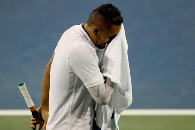Nick Kyrgios wipes his face between points while playing Karen Khachanov (AFP Photo/MATTHEW STOCKMAN)