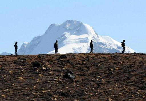 Indian soldiers keep vigilance at Bumla pass at the India-China border in Arunachal Pradesh, on October 21, 2012