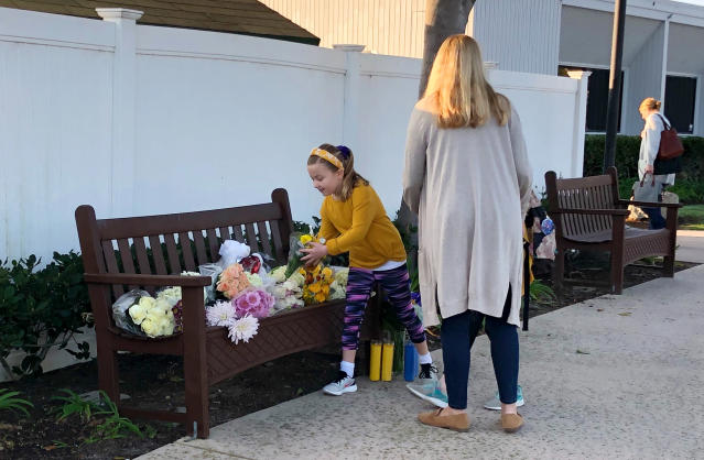 Flowers were placed at Harbor Day School, where Christina Mauser was a girls basketball coach. She was one of the nine who died on Sunday. (AP Photo/Amy Taxin)