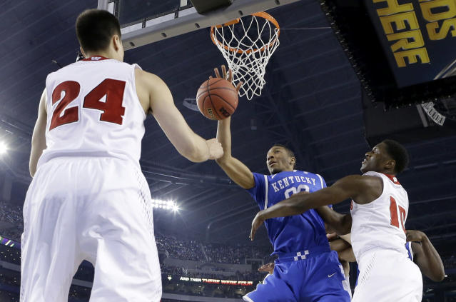 Wisconsin guard Bronson Koenig (24) and forward Nigel Hayes (10) defend against Kentucky forward Marcus Lee (00) during the first half of the NCAA Final Four tournament college basketball semifinal game Saturday, April 5, 2014, in Arlington, Texas. (AP Photo/Eric Gay)