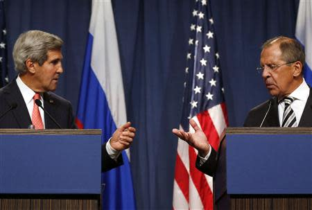U.S. Secretary of State John Kerry (L) and Russian Foreign Minister Sergei Lavrov gesture, following meetings regarding Syria, at a news conference in Geneva September 14, 2013. REUTERS/Larry Downing