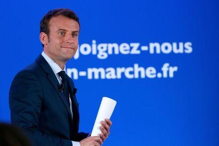 Emmanuel Macron, head of the political movement En Marche !, or Onwards !, and candidate for the 2017 French presidential election, leaves after a news conference at his campaign headquarters in Paris