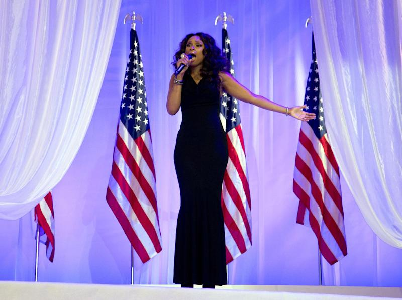 """FILE - In this Monday, Jan. 21, 2013,  file photo, Jennifer Hudson sings at the Inaugural Ball, in Washington, during the 57th Presidential Inauguration.  The NFL announced Thursday, Jan. 31, 2013, that Jennifer Hudson will join the chorus from Sandy Hook Elementary School to sing """"America the Beautiful"""" before Sunday's Super Bowl game. (AP Photo/Carolyn Kaster)"""