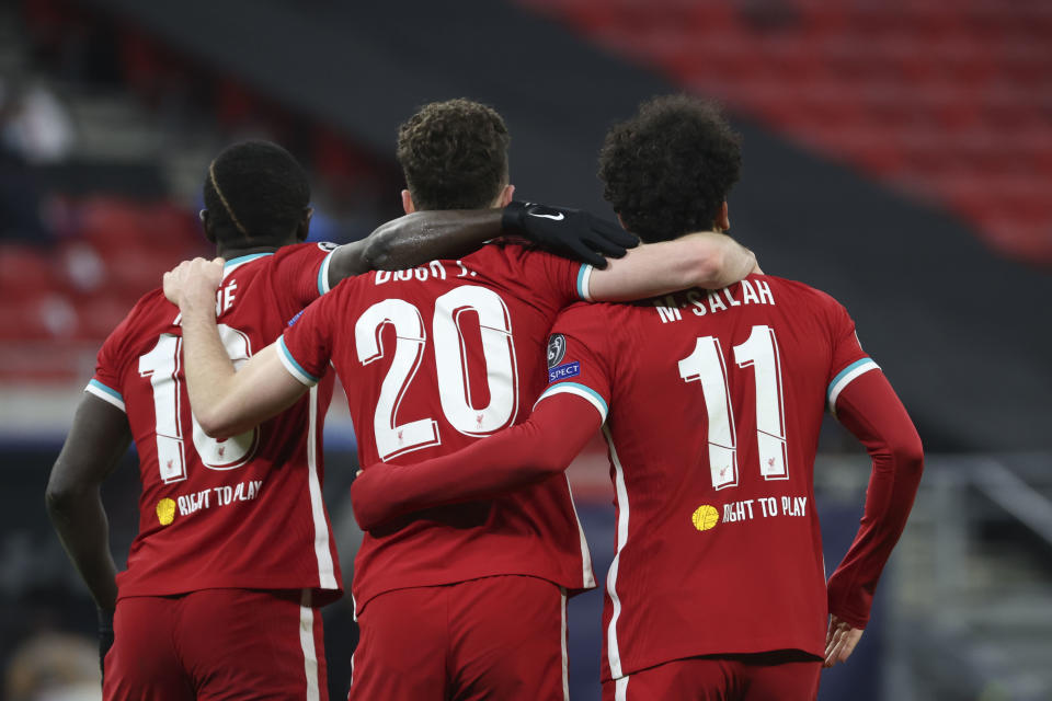 BUDAPEST, HUNGARY - MARCH 10: (BILD ZEITUNG OUT) Mohamed Salah of FC Liverpool with Diogo Jota of FC Liverpool and Sadio Mane of FC Liverpool celebrates after scoring his team's first goal during the UEFA Champions League Round of 16 match between Liverpool FC and RB Leipzig at Ferenc-Puskas-Stadion on March 10, 2021 in Budapest, Hungary. (Photo by Peter Zador/DeFodi Images via Getty Images)