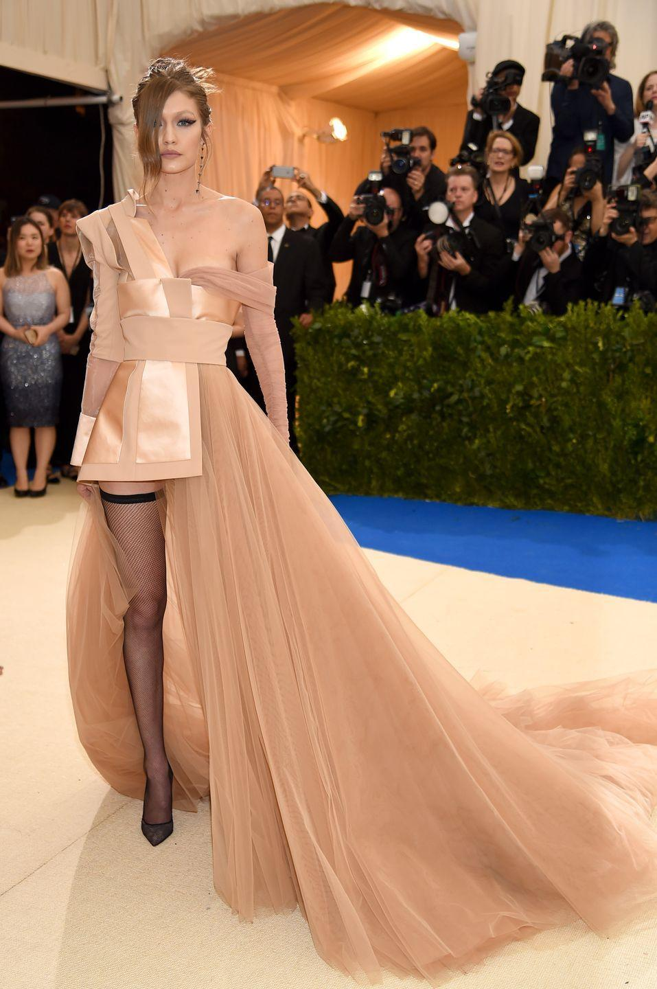 <p>The asymmetrical design and belted detail on the Tommy Hilfiger gown Gigi Hadid wore to the 2017 Met Gala remind us of Mulan's army attire.</p>