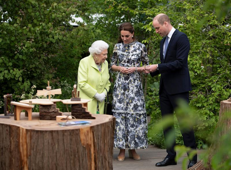 Kate shows the Queen some of the garden's features [Photo: PA]