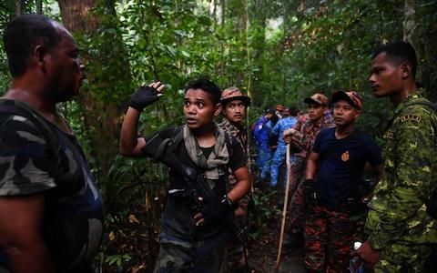 A 350-person search party searched for Nora before she was found on Tuesday - Credit: MOHD RASFAN/AFP