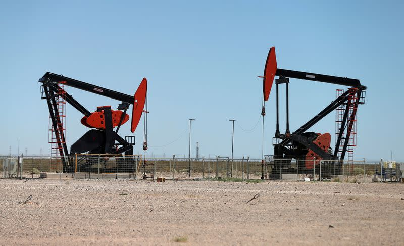 FILE PHOTO: Oil pump jacks are seen at Vaca Muerta shale oil and gas drilling, in the Patagonian province of Neuquen