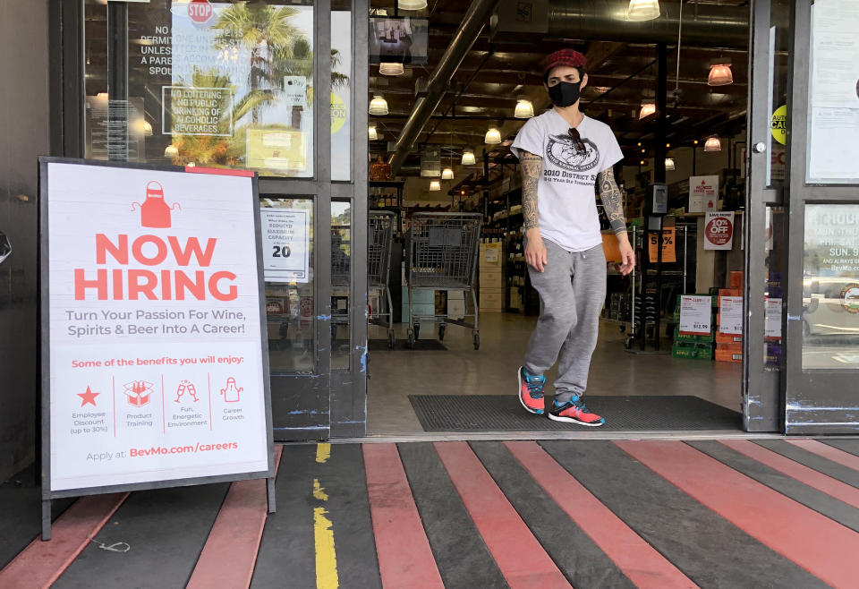 LARKSPUR, CALIFORNIA - APRIL 02: A customer walks by a now hiring sign at a BevMo store on April 02, 2021 in Larkspur, California. According to a report by the Bureau of Labor Statistics, the U.S. economy added 916,000 jobs in March and the unemployment rate dropped to 6 percent. Leisure and hospitality jobs led the way with 280,000 new jobs followed by restaurants with 176,000 jobs and construction with 110,000 new positions. (Photo by Justin Sullivan/Getty Images)