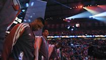 Portland Trail Blazers' including Damian Lillard honor coach Jack Ramsay whose number is spotlighted at top right prior to the first half of game six of an NBA basketball first-round playoff series game in Portland, Ore., Friday May 2, 2014. (AP Photo/Greg Wahl-Stephens)