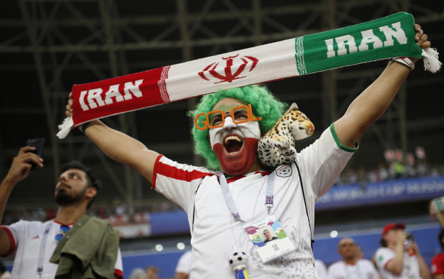 An Iranian fan cheers on his team as they warm up prior to the start of the group B match between Iran and Portugal at the 2018 soccer World Cup at the Mordovia Arena in Saransk, Russia, Monday, June 25, 2018. (AP Photo/Francisco Seco)