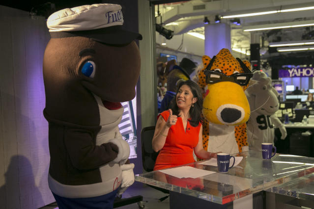 <p>Yahoo Finance Anchor and Reporter Alexis Christoforous is flanked by company mascots Fudgie the Whale and Chester the Cheetah, brought in as interns for the day at Yahoo Studios in New York City on Sept. 25, 2017. (Photo: Gordon Donovan/Yahoo News) </p>