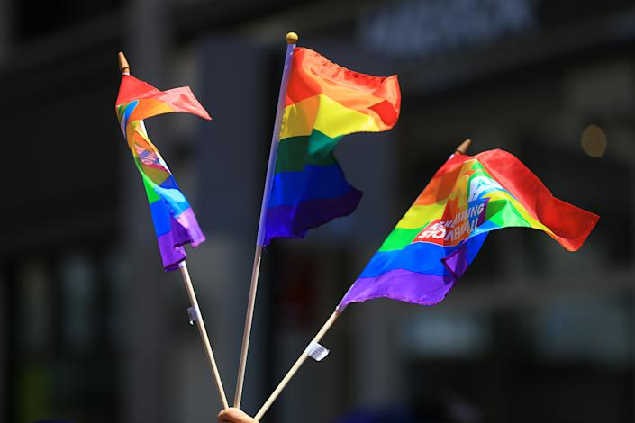 People wave rainbow flags during the NYC Pride Parade in New York, Sunday, June 30, 2019. (Gordon Donovan/Yahoo News)