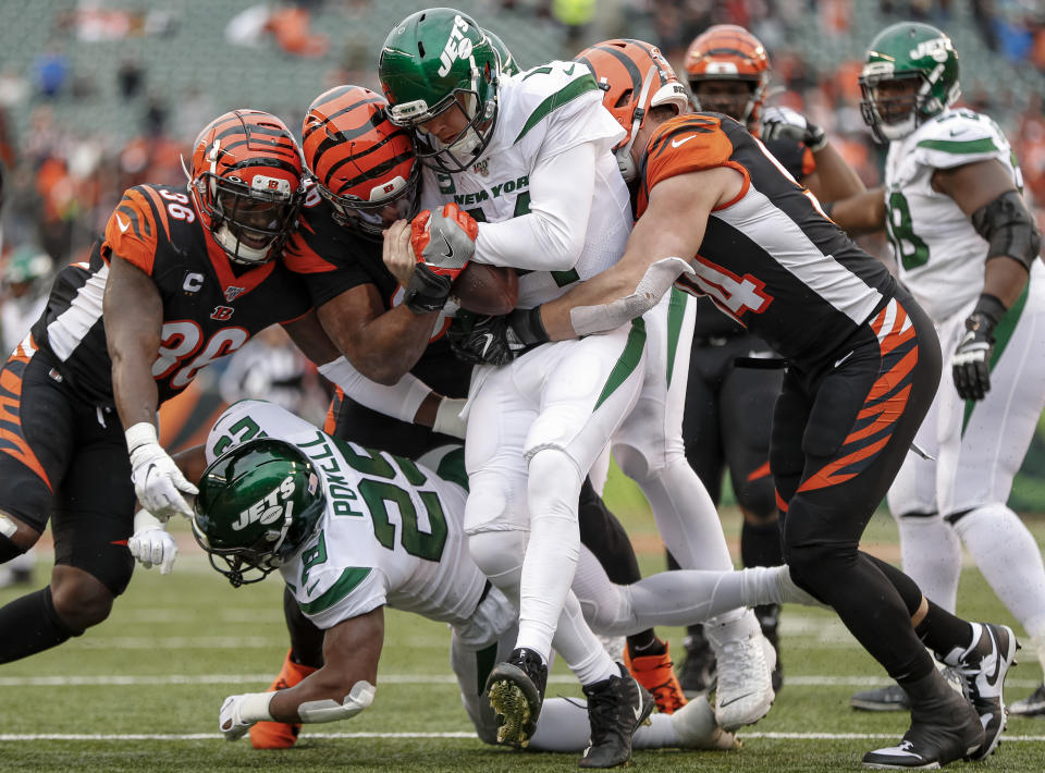 CINCINNATI, OH - DECEMBER 01: Sam Darnold #14 of the New York Jets is sacked by a host of Cincinnati Bengals defenders during the second half at Paul Brown Stadium on December 1, 2019 in Cincinnati, Ohio. (Photo by Michael Hickey/Getty Images)